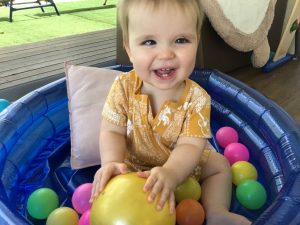 Max smiling in ball pit